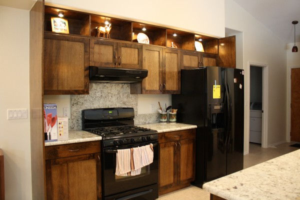 kitchen with custom cabinets and lighting