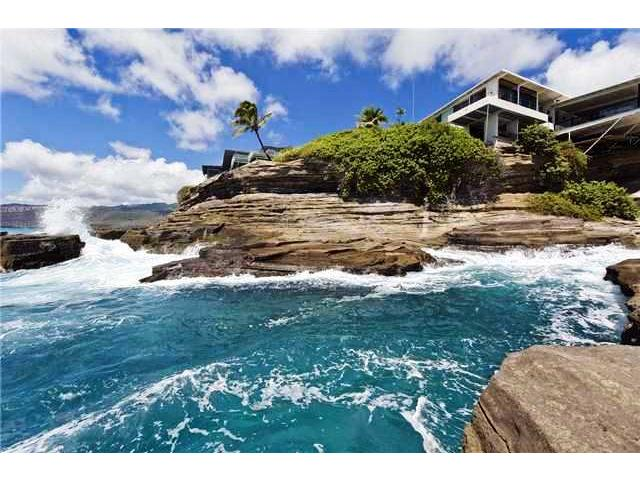 In front of the house is a beautiful cove with a blow hole seen