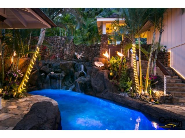Step Down into this Beautiful Oasis with Waterfalls, Gas Tiki To