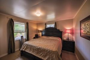 Master bedroom in adorable Ninole plantation home.
