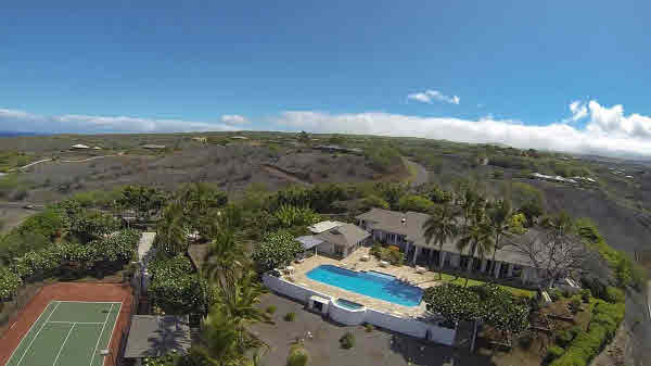 Kohala Ranch home with tennis court
