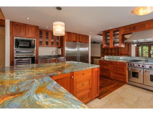 African Mahogany cabinets, topped with this exquisite stone coun