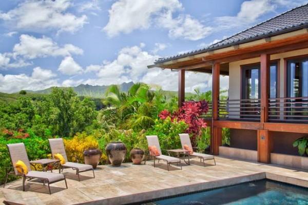Verdant Kauai surrounds the sunny poolside area