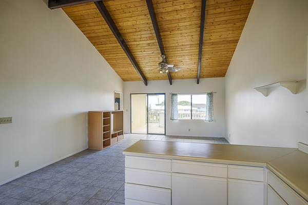 Vaulted wood-beam ceilings and lots of natural light lend a light and airy feel to the open concept floor plan
