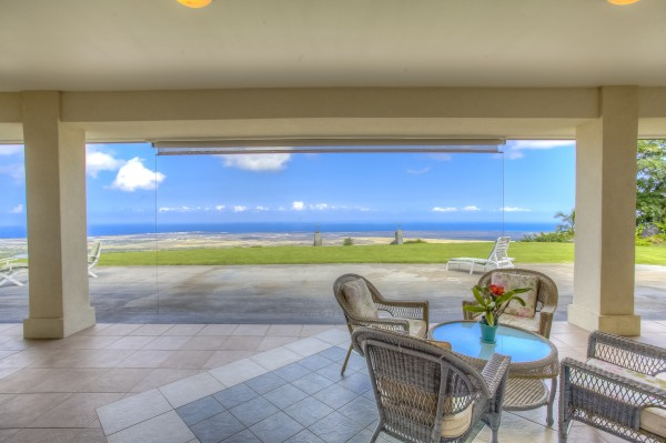 Panoramic ocean and sunset views from the expanded covered lanai