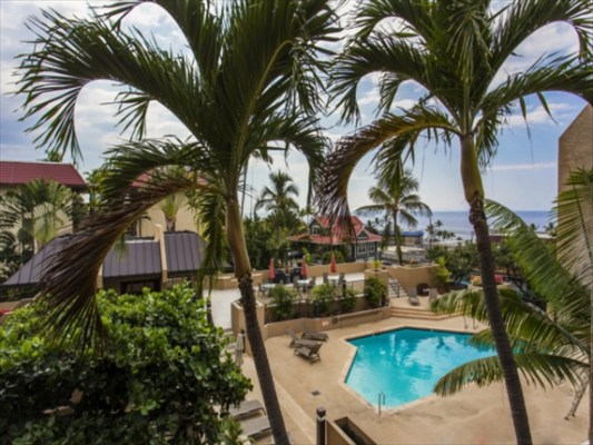 Ocean and pool view from your wrap around lanai