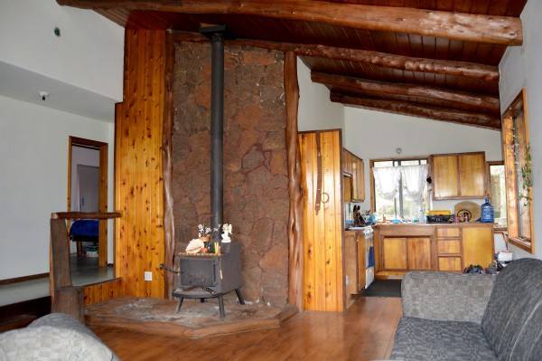 A wood burning stove takes care of the home's heating needs