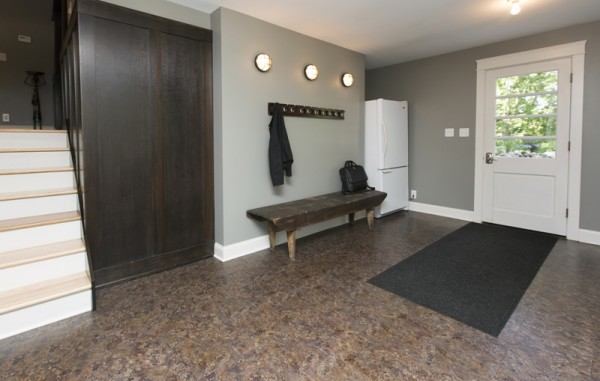 A simple yet large mud room makes coming and going much easier