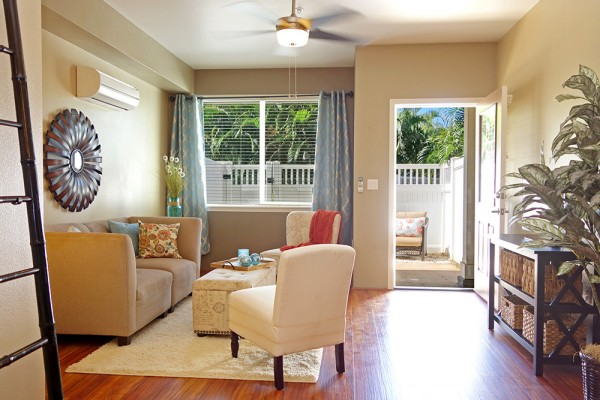 Bright and airy living room leads to a private lanai