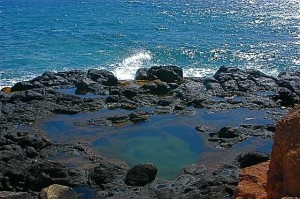 Tide pool with black lava rook
