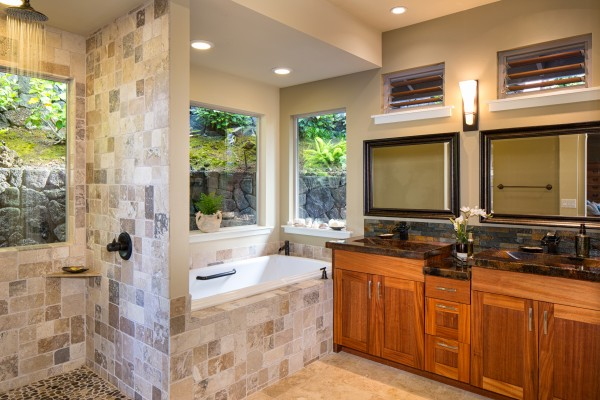 The large ensuite master bath features a rain shower faucet in the separate shower and a large soaking tub.