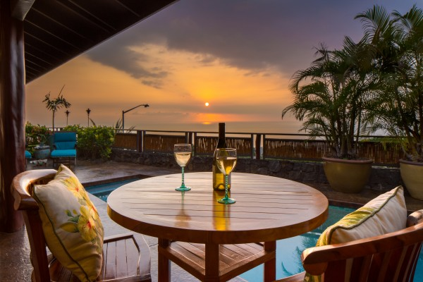 Enjoy incredible ocean sunset views from this custom-built luxury home above Kailua-Kona.