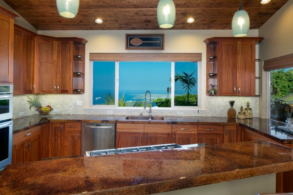 Incredible Kona coast views, top-notch appliances, a 6-burner gas stove, bar seating and more make this an incredible space to entertain.