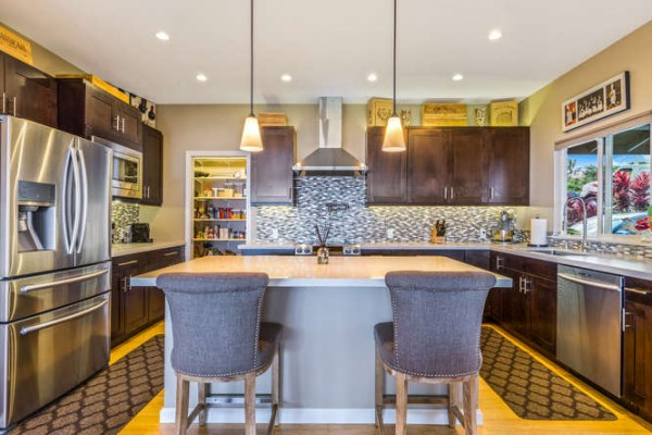 kitchen and kitchen island with pendant lights.